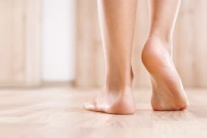 Walking barefoot across wooden floor